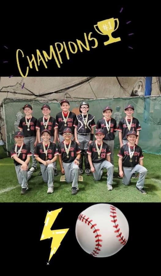 11U FLash boys baseball team kneeling with championship medallions