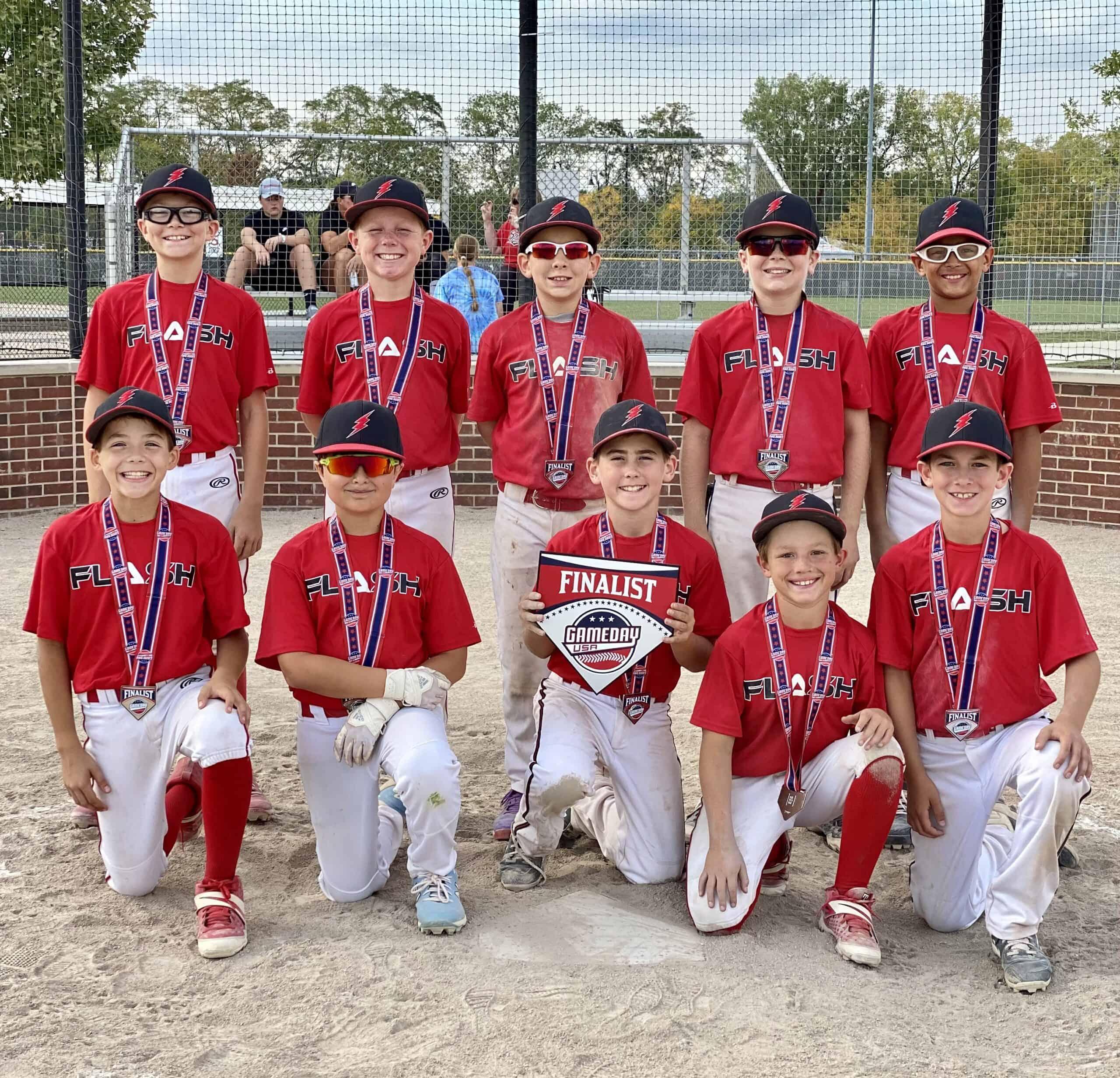 11U Flash baseball team kneeling holding a Gameday finalist home plate
