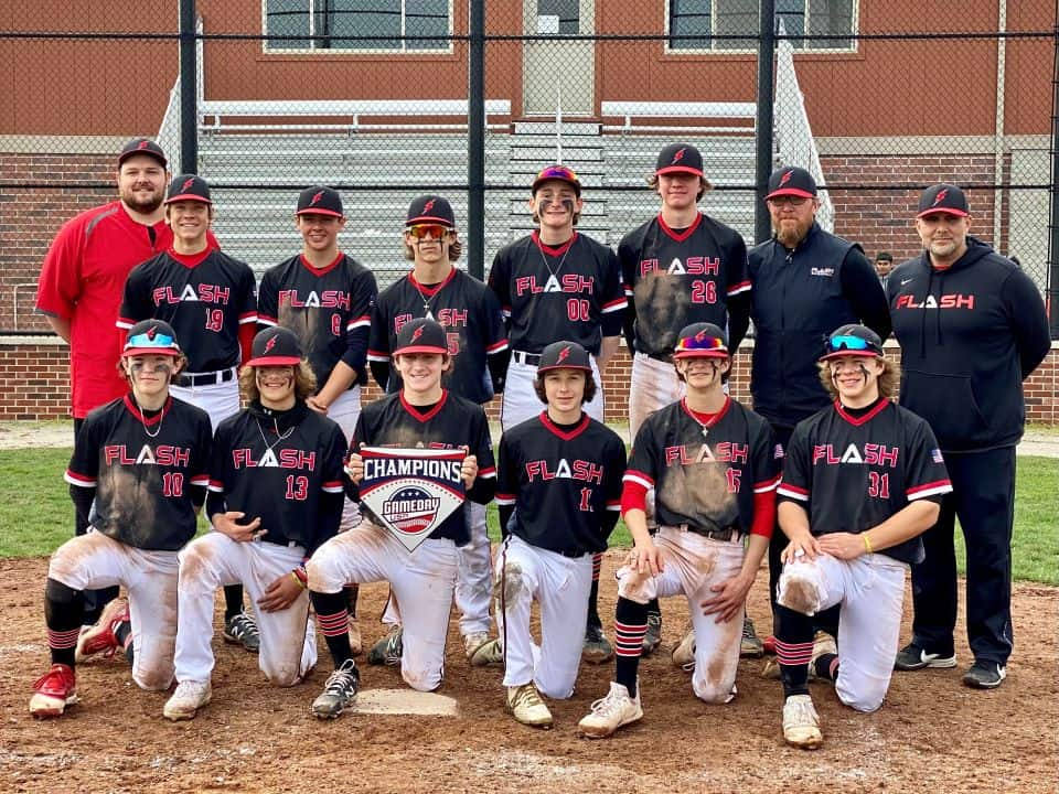 14U Flash baseball team with coaches holding Gameday championship home plate