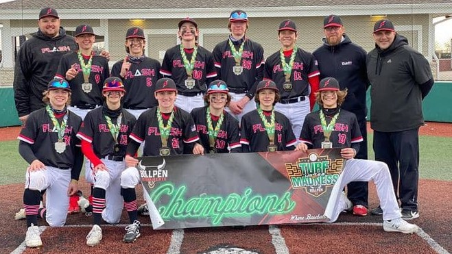 14U Flash boys baseball team with coaches holding up a Turf Madness USSSA championship banner