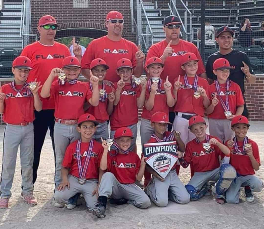 9U Flash baseball team with Gameday homeplace wearing championship medals