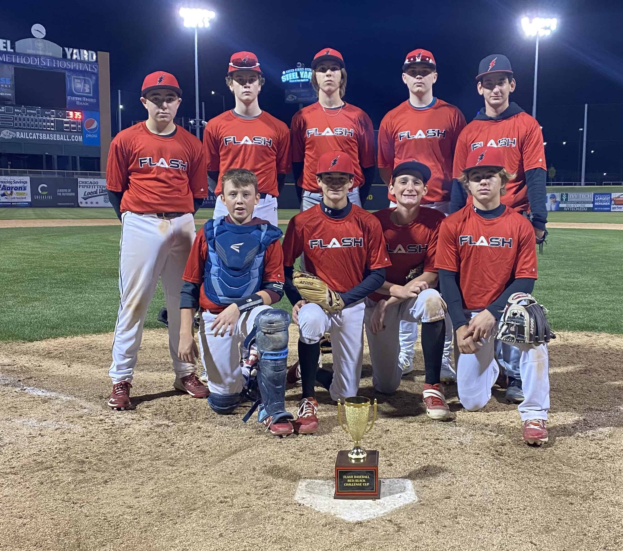 16U Red Flash baseball Team kneeling in front of the Red/Black trophy cup