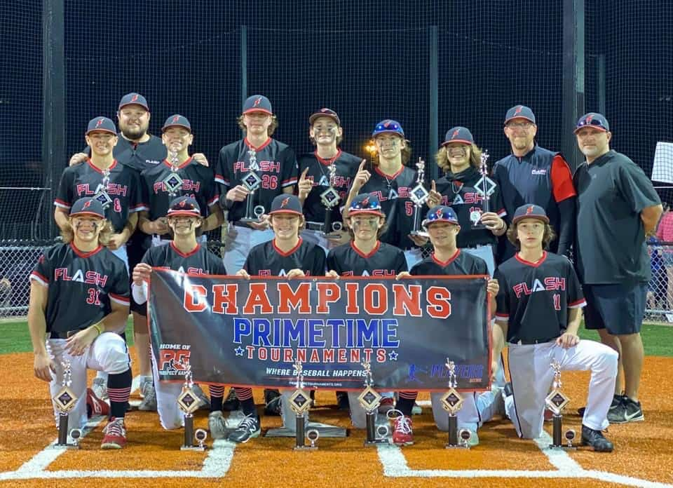 14 U boys Flash baseball team and coaches holding trophies and a Primetime Tournaments Champions banner